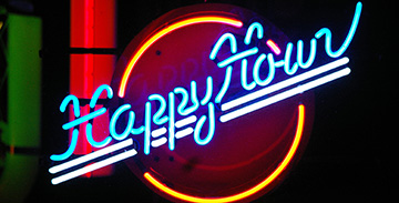 Picture of neon sign that reads Happy Hour