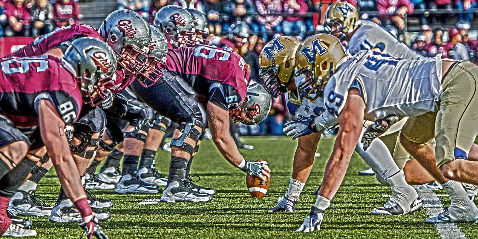 Picture of Montana and Montana State football players lined up against each other