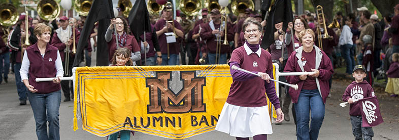 Alumni Band marching in 2016 Homecoming parade