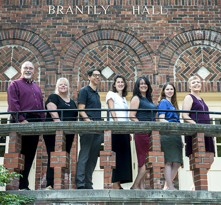 Alumni staff on front step of Brantly Hall