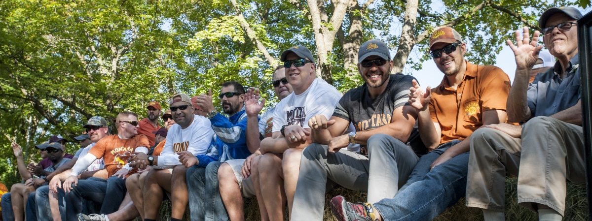 Parade Marshal Don Read rides a float with members of the '95 National Championship Grizzly Football Team in the 2015 Homecoming Parade