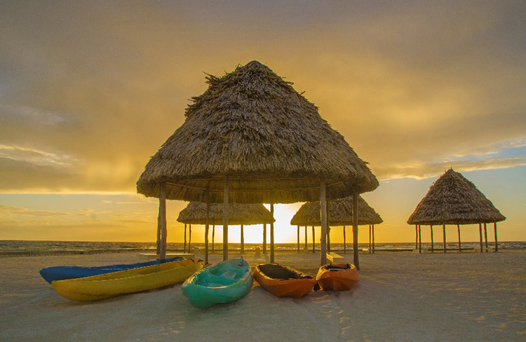 Picture of huts and kayaks in Belize