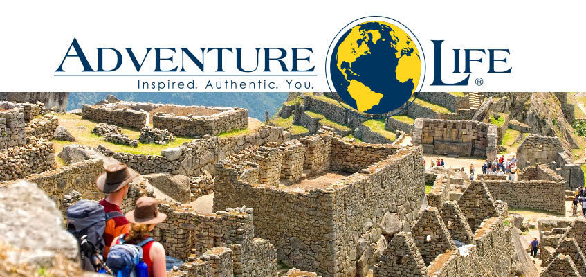 Picture of hikers at Macchu Picchu with Adventure Life logo