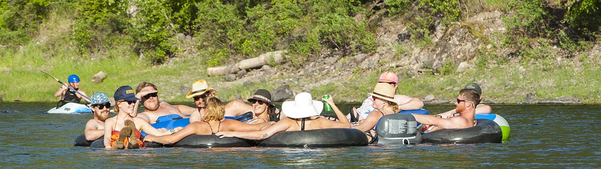 People floating in rafts on the Clark Fork River