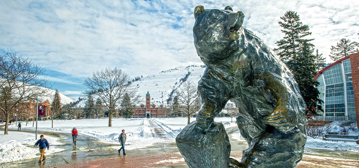 Grizzly statue with snowy campus in the background
