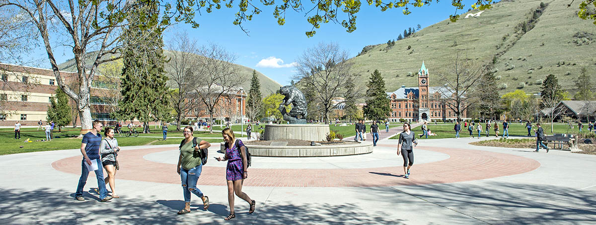 University of Montana Students walking on campus in the sunshine