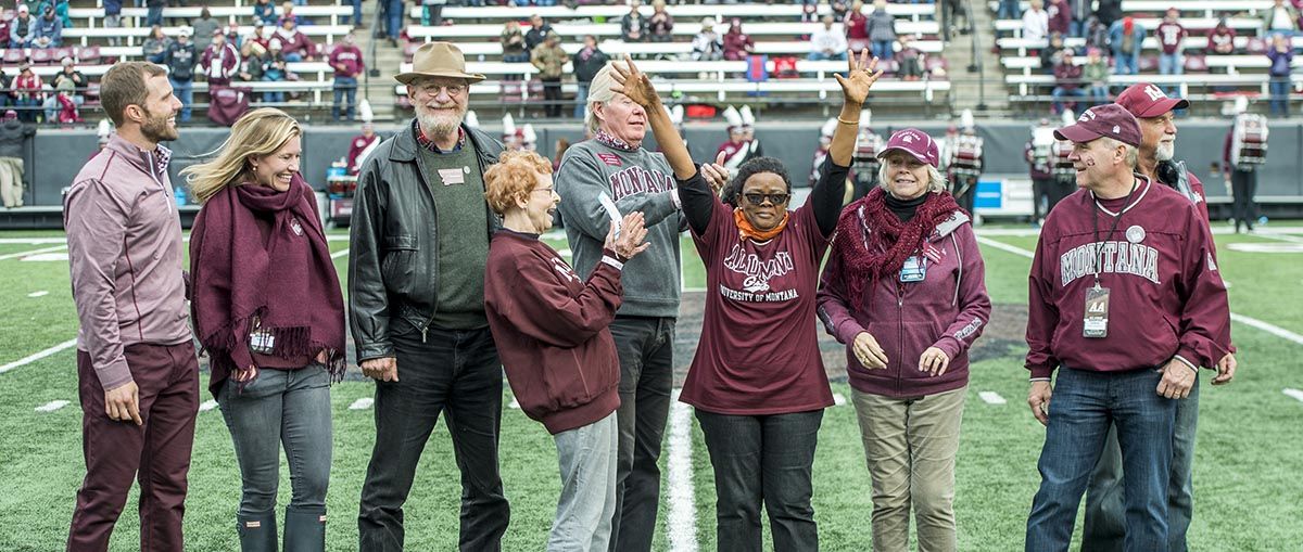 Picture of University dignitaries and 2018 Distinguished Alumni Award winners on football field