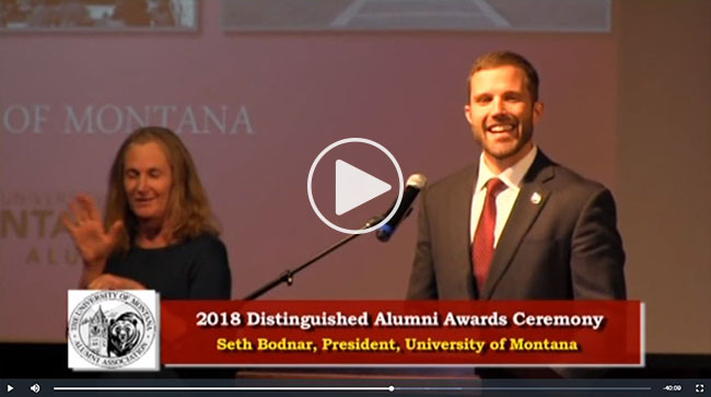 Still capture from 2018 Distinguished Alumni Award ceremony showing President Seth Bodnar and sign language interpreter